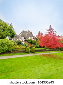 Luxury house with a red maple tree in Vancouver, Canada.