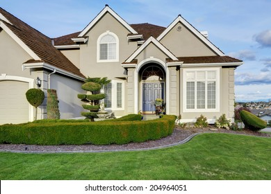 Luxury house with small entrance porch, walkway and curb appeal