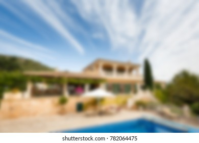 Luxury house in summer, creative blur backdrop with bokeh effect
