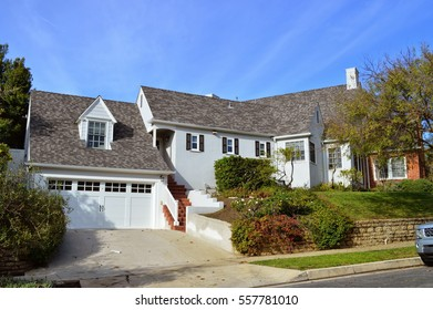 Luxury Houses and estates with a nicely landscaped front yard in an upscale neighborhood of Westwood, CA.