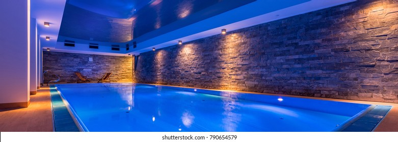 Luxury indoor swimming pool in modern hotel spa, panorama