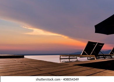 Luxury infinity pool with sunbed and terrace  very beautiful and relax with sunset sky