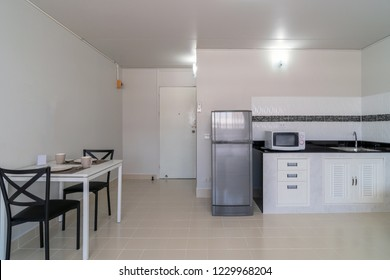 Luxury Interior bedroom with leather sofa of living room and kitchen in the same area, Studio room type of condominium or apartment, service apartment and Accommodations Concept