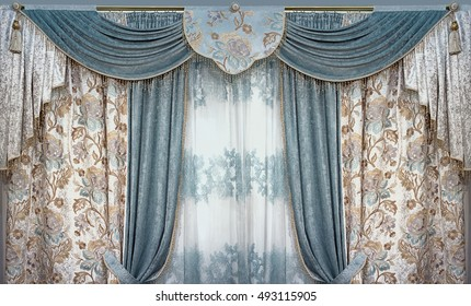 Luxury interior is decorated in the palace style. Curtains, pelmet and tulle from natural materials