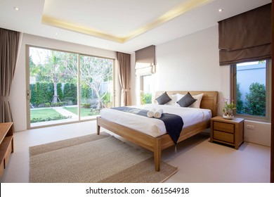 Luxury Interior design in bedroom of pool villa with cozy king bed. Bedroom with high raised ceiling  home, house ,building