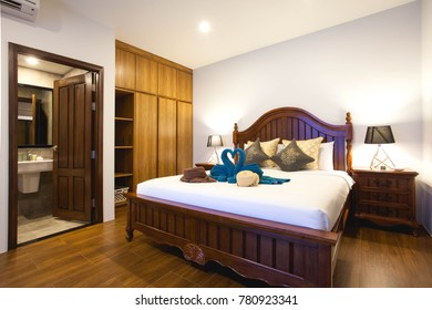 Luxury Interior design in bedroom of pool villa with cozy king bed. Bedroom with high raised ceiling