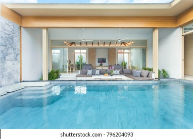 Luxury interior design in living room of pool villas. Airy and bright space with high raised ceiling and wooden dining table home, house, building , resort