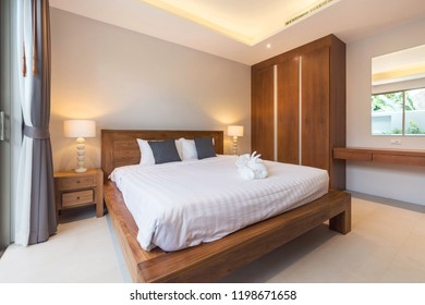Luxury Interior design in modern bedroom of pool villa with cozy king bed.high raised ceiling in the  home, house , building , hotel , resort