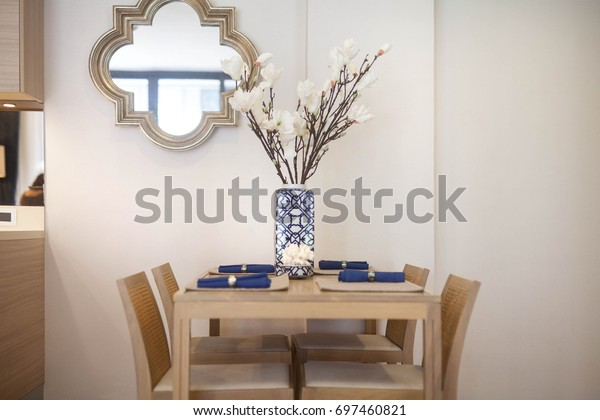 Luxury interior design in modern living room of pool villas.  wooden dining table , home, house , building , hotel