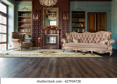 Luxury interior of home library. Sitting room with elegant furniture