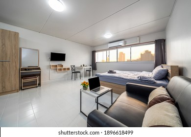 Luxury Interior living room with sofa bed and bed queen size, Dining table,air conditioner, and furniture, Studio room type of condominium or apartment, service apartment and Accommodations Concept
