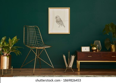 Luxury interior with stylish chair, wooden commode, mock up poster frame, plants, carpet, gold decoration and elegant personal accessories. Modern living room in classic house. Template. - Shutterstock ID 1869826453