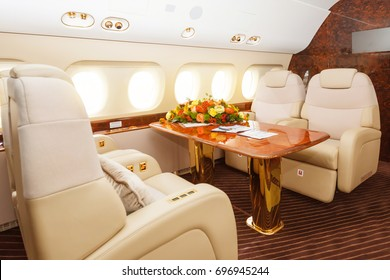 Luxury interior in warm colors of genuine leather in the modern business jet