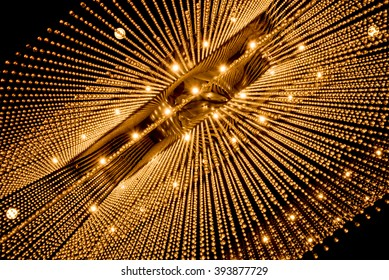 Luxury interiors of Chandelier Light pattern background at modern building.