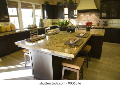 Luxury kitchen with a breakfast counter.