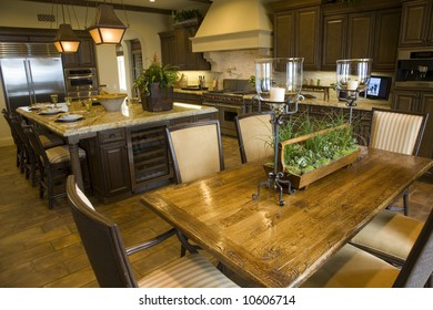 Luxury kitchen with hardwood table and chairs.