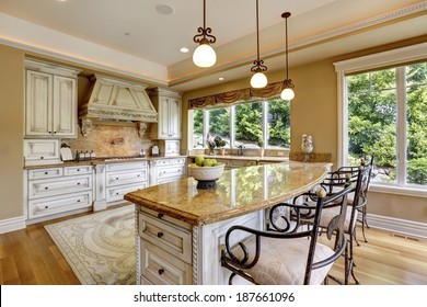 Luxury kitchen room with island and chairs.