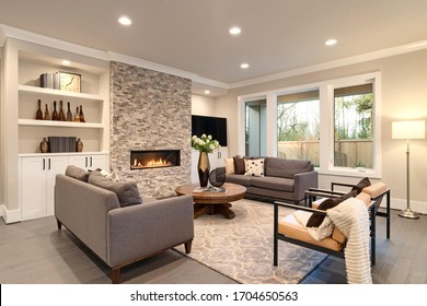 Luxury large natural modern and rustic living room interior with brown sofas.