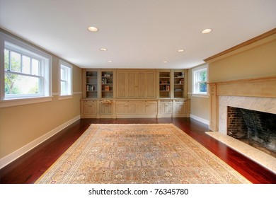 Luxury large room with cherry mahogany hardwood floor and custom made cabinets with entertainment center. Basement in a historical luxury home in Tacoma, WA
