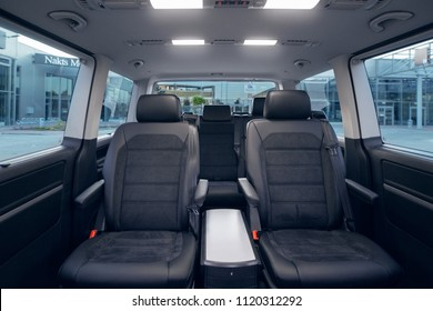 Luxury leather seats in the comfortable van. Interior of luxury minivan with backlight, transfer car
