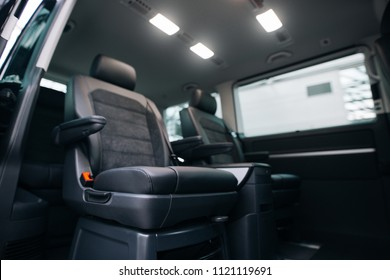 Luxury leather seats in the van. Interior of luxury minivan.