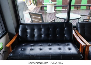 Luxury leather sofa wood arm in vintage cafe, Interior furniture