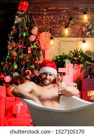 Luxury life. Sexy hedonist relax in bathtub. Hedonism concept. Stunning winter views enjoyed from bathtub. Apartment with bathtub. Man celebrate new year lying in bathtub with glass of sparkling wine.