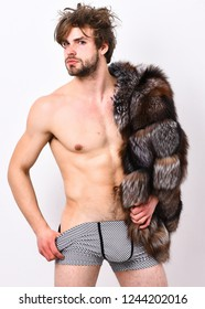 Luxury lifestyle and wellbeing. Sexy sleepy macho tousled hair isolated on white. Luxury status symbol. Bachelor rich lover. Richness and luxury concept. Guy attractive posing fur coat on naked body.