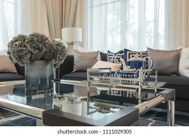 luxury living room with elegant sofa and set of pillows in classic house style, interior design concept