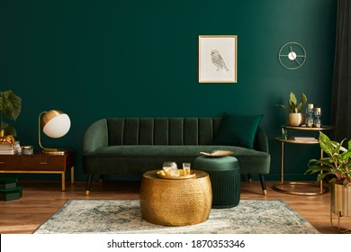 Luxury living room in house with modern interior design, green velvet sofa, coffee table, pouf, gold decoration, plant, lamp, carpet, mock up poster frame and elegant accessories. Template.