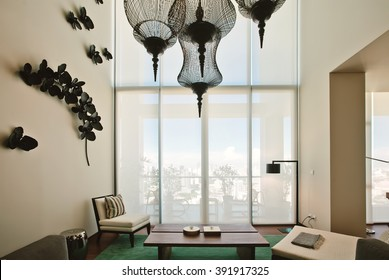 Luxury Living room interior design. Big window, city centre view, high ceiling