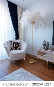 Luxury living room. White sofa set. Ostrich feather lampshade. Single seat in the Rest Corner.