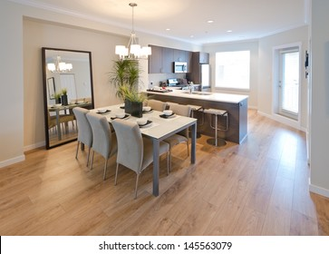 Luxury living suite : dining room and the kitchen at the back . Interior design.