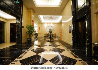 Luxury lobby interior.With crystal lamp,bing hall, marble floor, french sash,mosaic tile,comfortable sofa, etc.