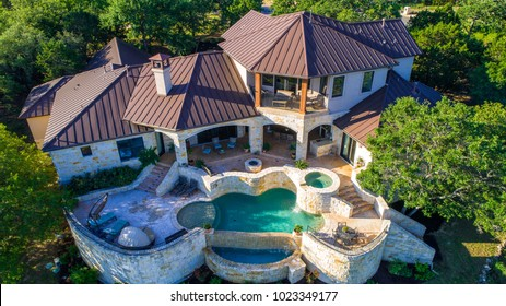 Luxury mansion on large lot of land with Texas hill country landscape and surrounding green surroundings of the ranch country home with infinity pool and wealthy real estate living by