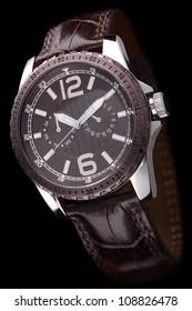 Luxury men's watch isolated. Black background
