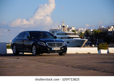 Luxury mercedes limousine in the harbour of ibiza with a private yacht in the background. Ibiza, Balearic Islands, Spain. Summer, 05.07.2011