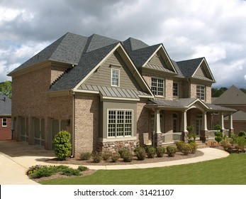 Luxury Model Home Exterior stormy weather angle view