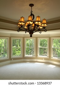 Luxury Model Home Round Master Bedroom with light fixture