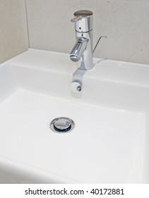 Luxury modern bathroom detail with designer water mixer tap