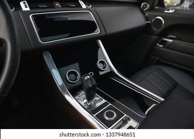Luxury, modern, black car interior with big displays.