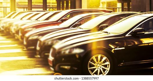 luxury modern Cars For Sale Stock Lot Row. Car Dealer Inventory. Cars For Sale Stock Lot Row. Car Dealer Inventory. sunset sun rays light. sun beam