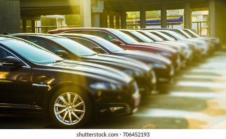 luxury modern Cars For Sale Stock Lot Row. Car Dealer Inventory. Cars For Sale Stock Lot Row. Car Dealer Inventory. sunset sun rays light. sun beam