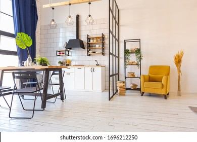 luxury modern design of a cozy small Scandinavian-style studio apartment with white walls, second floor with a library and huge high window full of day light