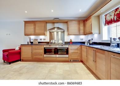 Luxury modern fitted kitchen with built in appliances and granite worktop