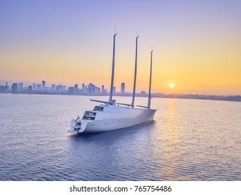 luxury moored yacht most expensive, tel aviv sunrise cityscape Mediterranean sea.