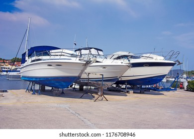 Luxury motor yachts at shipyard waiting for maintenance and repair