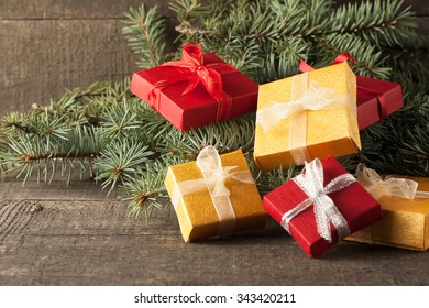 Luxury New Year Gifts, Different Present Boxes Under Christmas Tree In  Holiday Eve, Christmastime
