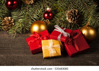 Luxury New Year gifts, different present boxes under Christmas tree in holiday eve, Christmastime celebration, home decorated with festive shiny balls, magic night