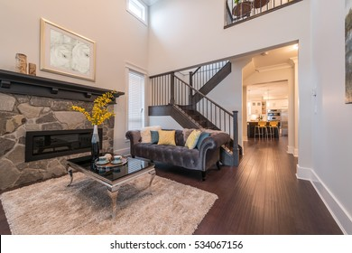 Luxury nicely decorated modern living room, suite with sofa and chairs. Interior design.